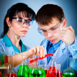 Schoolteacher and student — Stock Photo