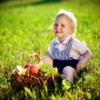 Little boy with a basket of fruit - Stock Photo