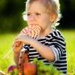 Little boy with a sweet — Stock Photo