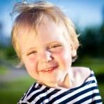 Happy child smiles — Stock Photo #9334851