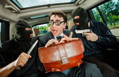 Businessman grasped in hostages. — Stock Photo