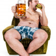 Fat man eating hamburger — Stockfoto