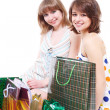 Two happy friends with purchases. — Stock Photo #10057424