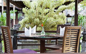 Little table in summer street cafe — Stock Photo