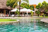Swimming pool in hotel in tropics — Stock Photo