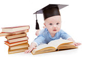Kid in a hat of the bachelor and the book. — Stock Photo