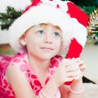 Little girl at a Christmas fir-tree — Stock Photo #8064342