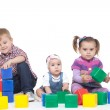 Boy and two little girls play bright cubes — Stock Photo