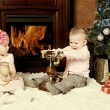 Happy children at a Christmas fur-tree — Stockfoto