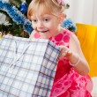 Little girl at a Christmas fir-tree — Foto Stock
