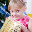 Little girl at a Christmas fir-tree — ストック写真