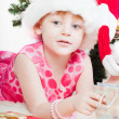 Little girl at a Christmas fir-tree — Stock Photo #8064418