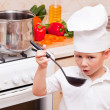 Little boy on kitchen helps to make a dinner — Stock Photo #8739692