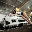 Stock Photo: Beautiful girl washes car