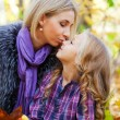 Happy mum and the daughter play autumn park - Stock Photo