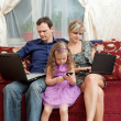 Family of three sitting on the couch — Stock Photo