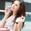 Girl tastes a smell just the spirits bought in shopping center — Stock Photo