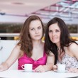 Two girls sitting in cafe in shopping center — Stock Photo #9674810