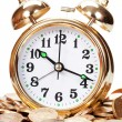 Stock Photo: Great golden alarm clock faces on coins
