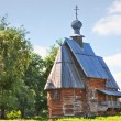 The traditional russian wooden church for tourists in the ancient town of Suzdal - Stock Photo