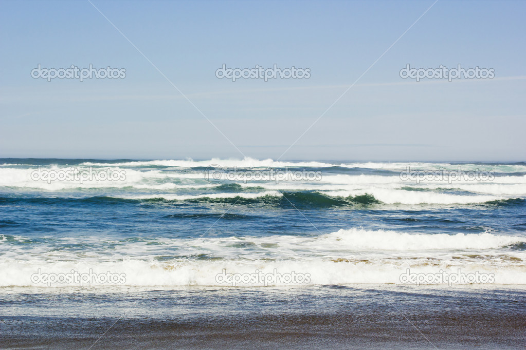 Scenic photograph of ocean waves on the beach.  Stock Photo #10378049