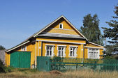 Small wooden country house — Стоковое фото