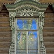 Old wooden window with carved decoration — Stock Photo