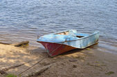 Metal boat on the riverbank — Stock Photo