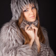 Portrait of a beautiful smiling woman in furs — Stock Photo #8909882
