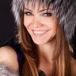 Portrait of a beautiful smiling woman in furs — Stock Photo
