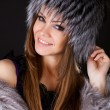 Portrait of a beautiful smiling woman in furs — Stock Photo #8909940
