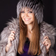 Portrait of a beautiful smiling woman in furs — Stock Photo #8909947
