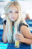 Portrait of a beautiful female model with juice — Stock Photo
