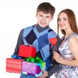 Young couple with gifts — Stock Photo