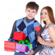 Young couple with gifts — Stock Photo #8986735