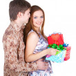 Young couple with gifts — Stock Photo #8986791