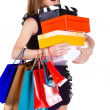 Beautiful young woman with shopping bags and gifts — Stock Photo