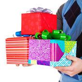 Present gifts in men's hands — Stock Photo
