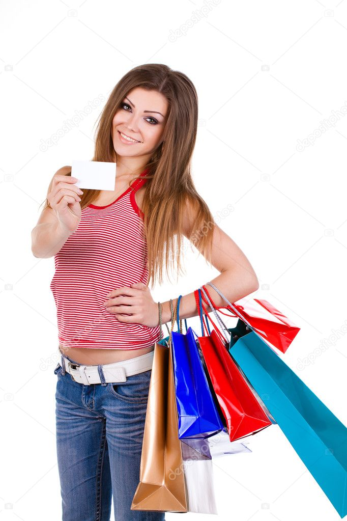 Young woman holding shopping bags and a card Isolated — Stock Photo #8986868