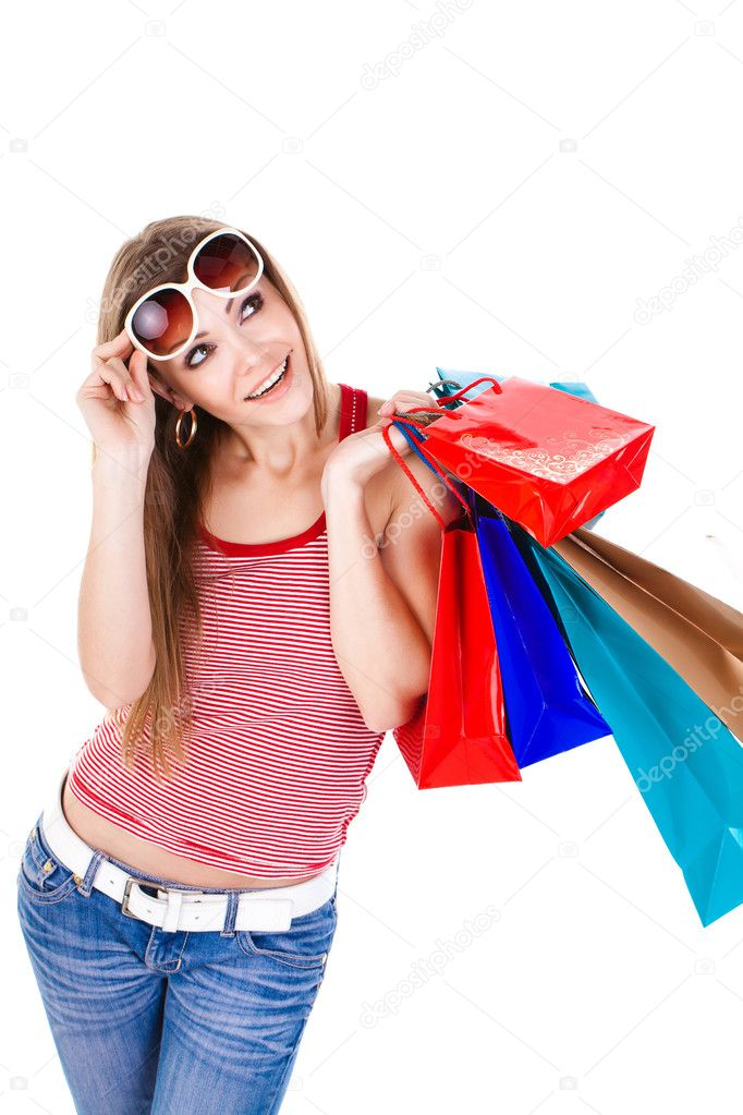 Young beautiful woman holding shopping bags isolated — Stock Photo #8986891
