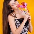 Beautiful young woman with hearts — Stockfoto