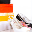 Stock Photo: Gift boxes and shoes isolated on white