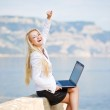Successful woman with a laptop — Stock Photo