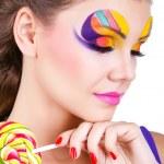 Portrait of a glamourous beautiful woman holding lollipop — Stock Photo #9124967