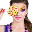 Portrait of a glamourous beautiful woman holding lollipop — Stock Photo #9125016