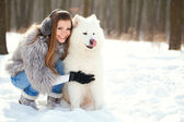 Beautiful woman with her dog samoyed — Stock Photo