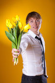Elegant man holding flowers — Stock Photo