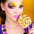 Portrait of a glamourous beautiful woman holding lollipop — Stock Photo