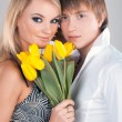 A portrait of a sweet couple in love with flowers — Stock Photo #9231725