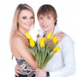 A portrait of a sweet couple in love with flowers — Stock Photo